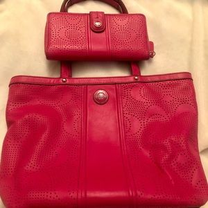 Coach leather handbag and matching wallet.